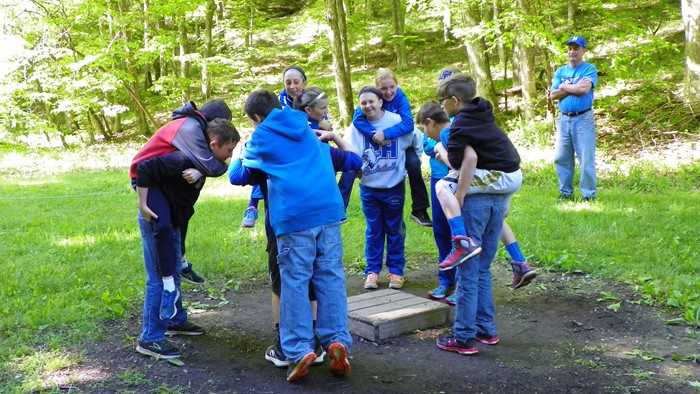 The Obstacle Course: The  Platform: Campers learn about Mean, Median, and Mode before stepping on the obstacle course,