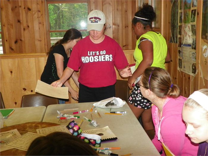 Owl Pellets: Mrs. Voyles watches as the campers dissect and owl pellet to determine what it has recently eaten.