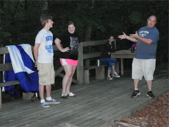 Campfire Skit: Chris tells the campers that he is going to see how smart Brianne and Austin are.