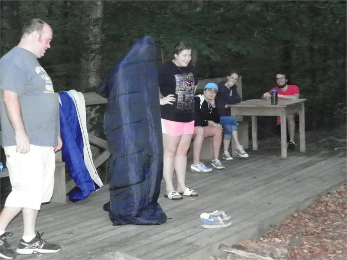 Campfire Skit: Austin has a sleeping bag over his head.
