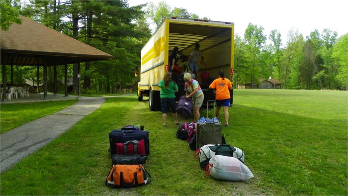 Unloading the campers gear before they arrive.