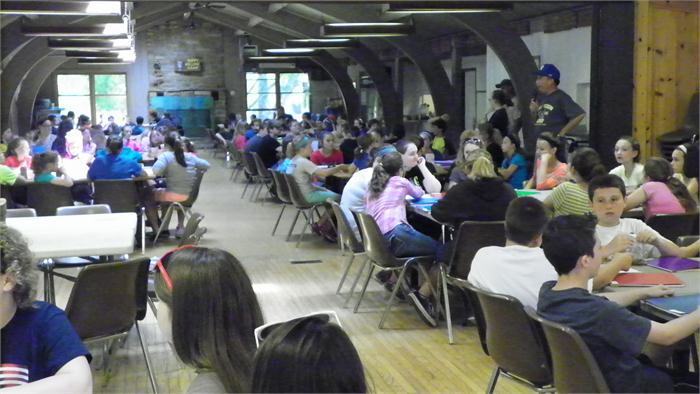 After eating lunch the campers entered the dining hall for a meeting with Mr. Schmidt.