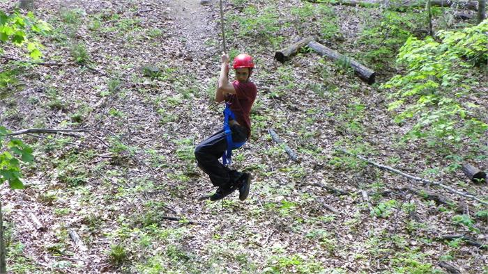 Cody L. took his turn on the zip line.