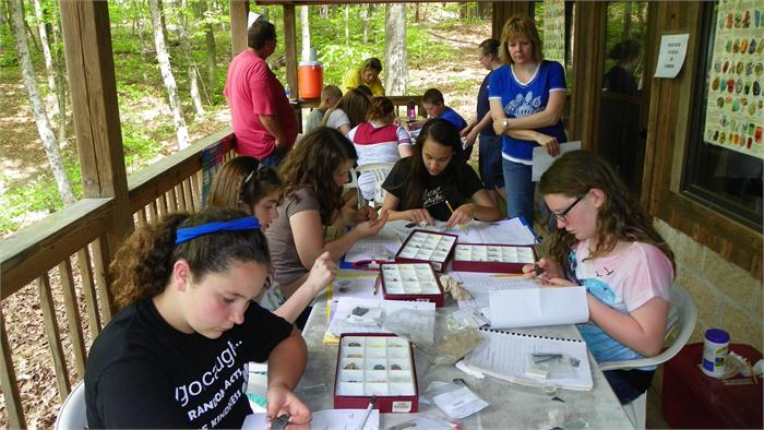 At station 8 - Minerals the campers learn to identify different minerals.