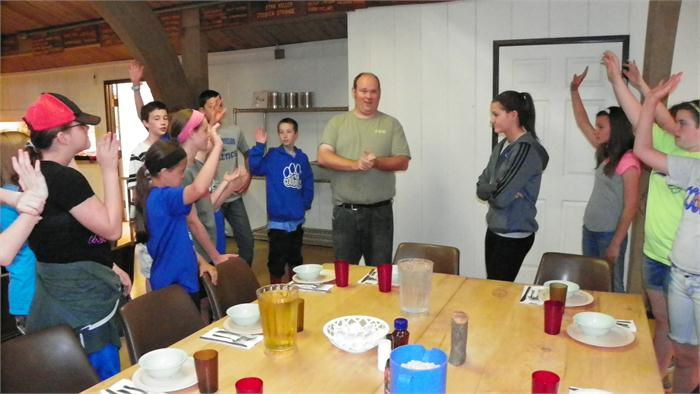 Breakfast: Chris, a Happy Hollow employee gives the campers directions on how to be a hopper.