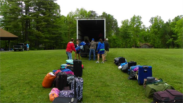 Unloading the gear for the campers to easily find theirs.