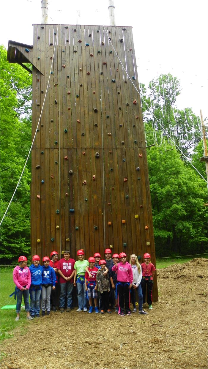 The Climbing Wall - All 40 Feet - Group 8 stands in front of the wall to give you an idea of how tall it really is.