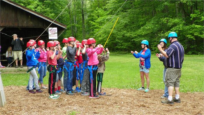 The Climbing Wall - All 40 Feet -Campers are given instructions about how to be a spotter for a climber.