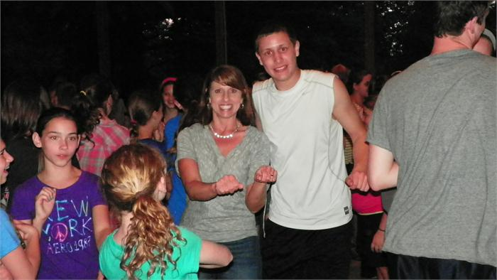 Mrs. Smith and her son Cory have some fun and cut a rug.