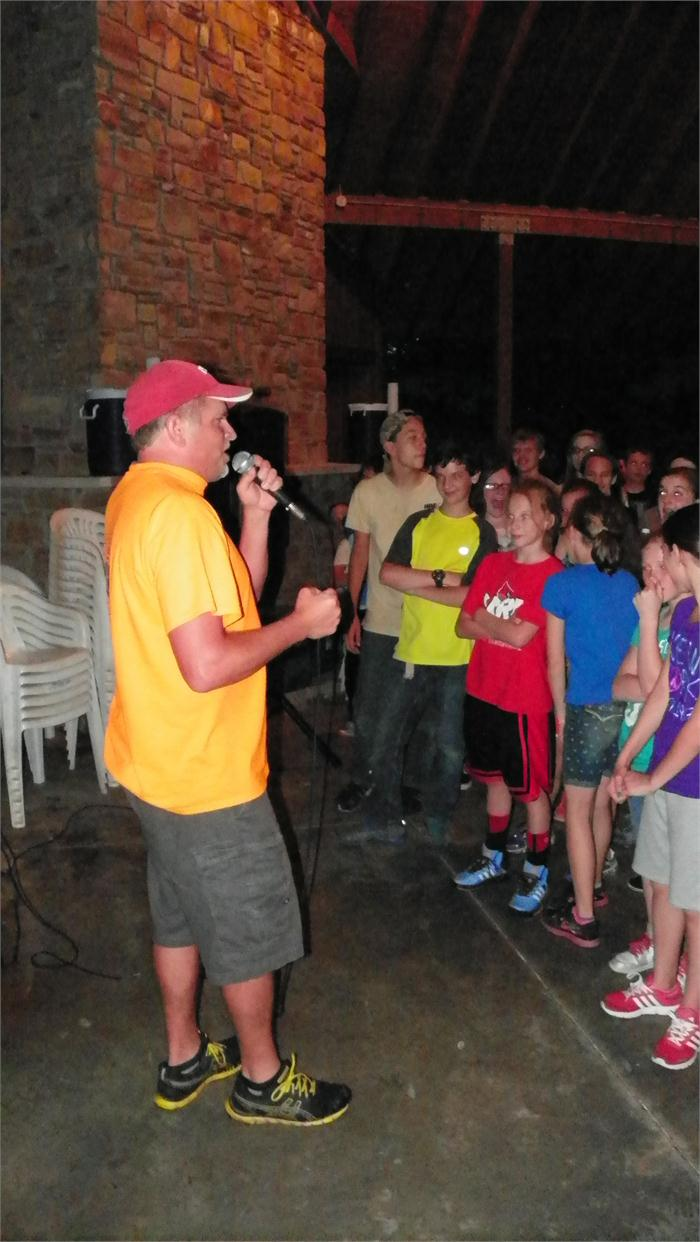 Mr. Walker sings a song for the group.