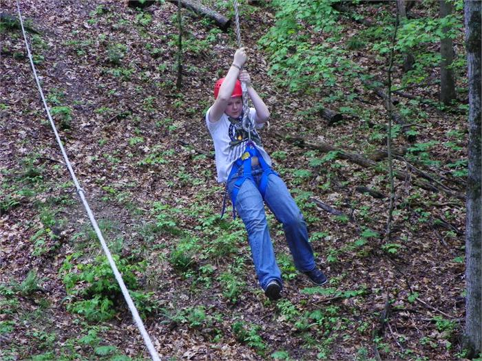 Zip Line: Joe S. glides across the gully.