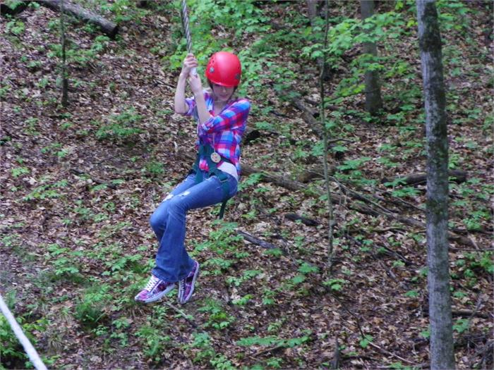 Zip Line: Jenna M. takes her turn on the zip line after Mr. Walker tried to play a joke on her.