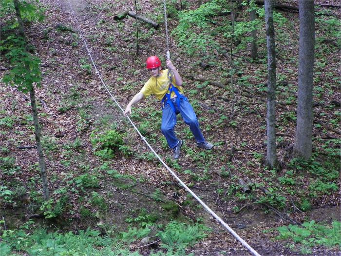 Zip Line: Robby K. grabs for the rope so he can pull him self closer to the start.