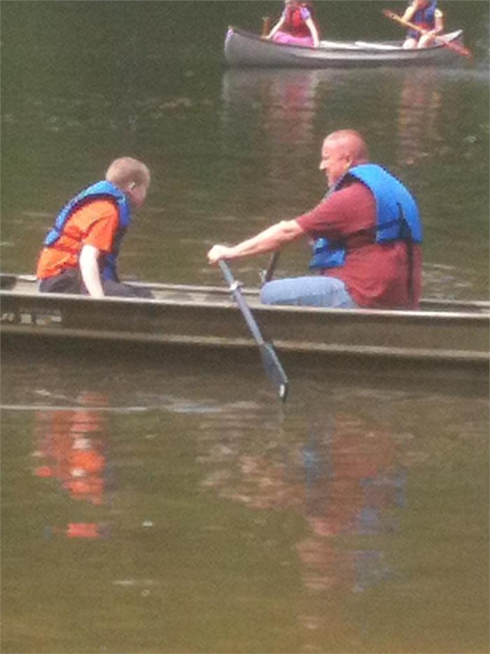 Josh enjoys getting to canoe with his dad.