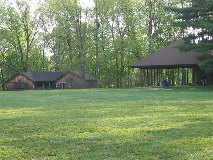 A picture of one of the girls cabins and the shelter house.